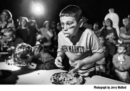Jerry Wolford winning image boy at pie eating contest with bulging eyes, cheeks, lips