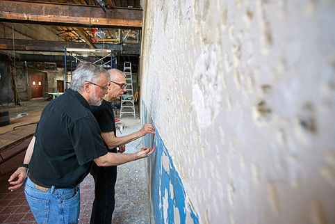 Peeling plaster from studio wall.