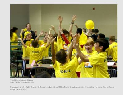 Children wearing yellow t-shirts celebrate Lego Blitz