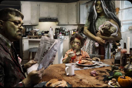 A family of zombies sits down for a meal.