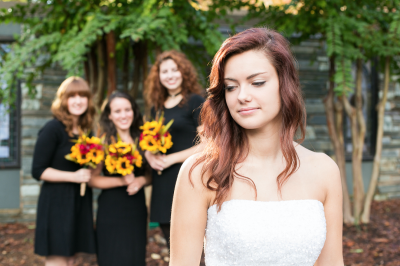 bride in front of three bridesmaids.